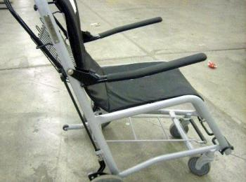 Staxi medical transport chair. Locking wheels. Property is located at Joint Base Elmendorf-Richardson Alaska. Preview & Lot Details